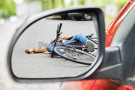 reflection of businessman sitting in car