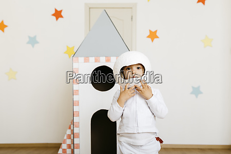 girl wearing costume and playing astronaut