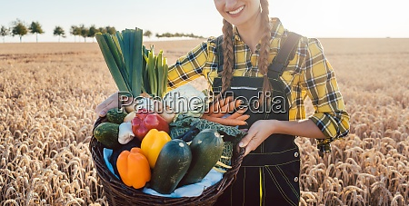 farmer woman offering healthy vegetables