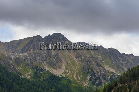 edgy mountains with rainclouds in the