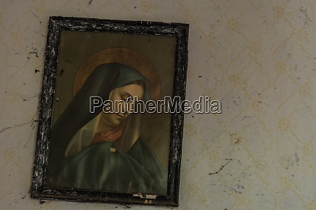 oblique hanging holy picture on the