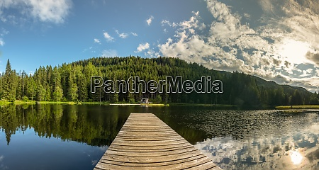 reflecting pond with wooden jetty in