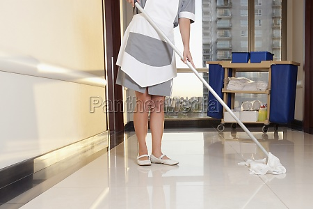 janitor cleaning the corridor of a