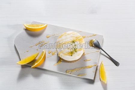 orange tarts with orange sauce and