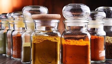 glass storage jars with spices and